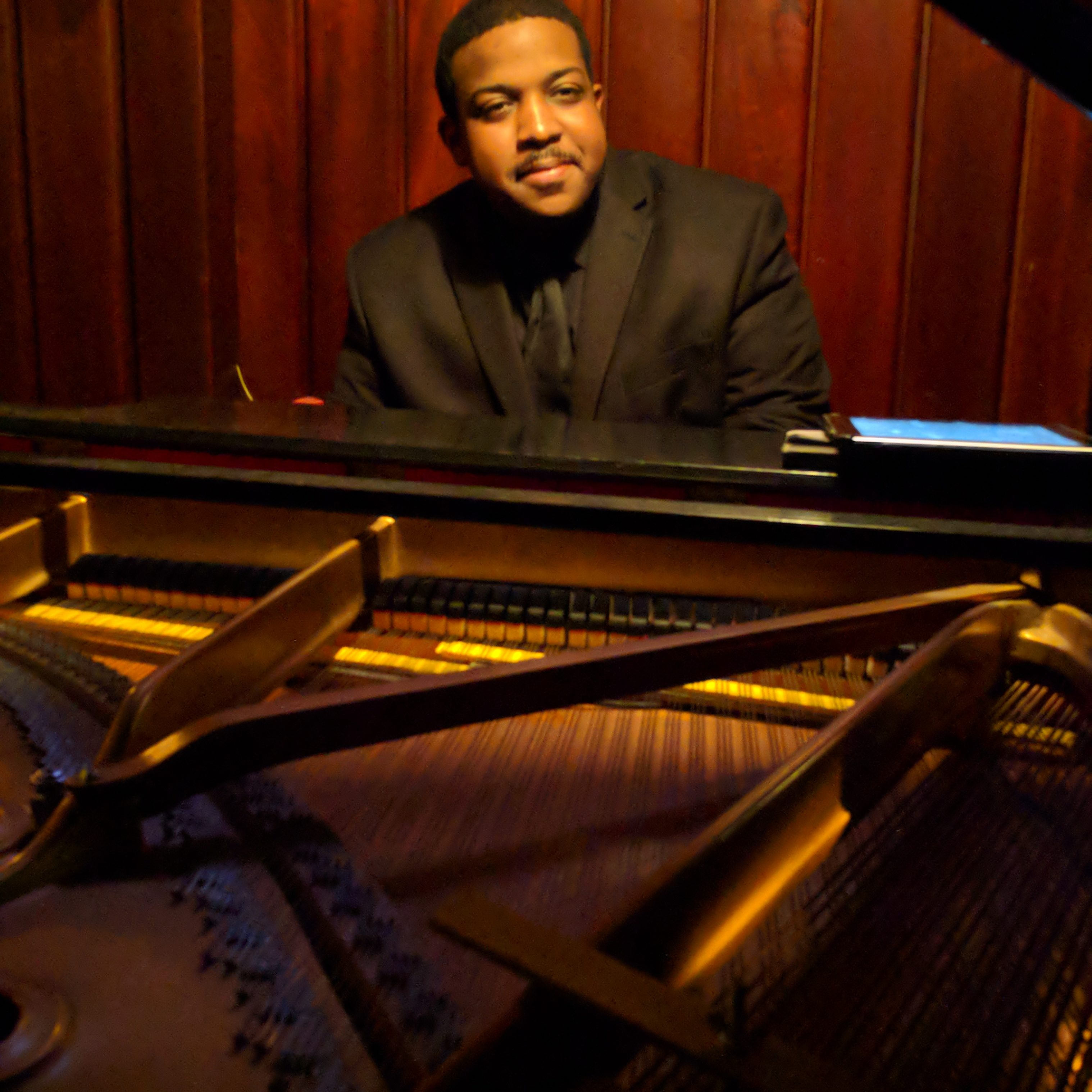 Pianist with the Garden District Band; Jordan Baker